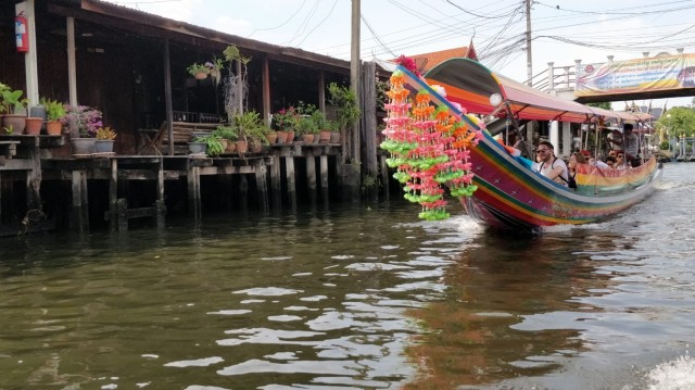 Colourful, traditional boat on a river in Thailand